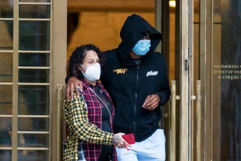 Former NBA basketball player Sebastian Telfair, right, departs Manhattan Federal Court, Thursda ...