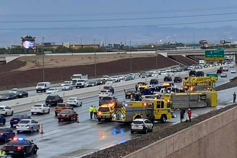 A Clark County fire truck has overturned on the 215 Beltway. (Glenn Puit/Las Vegas Review-Journal)