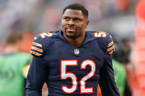 Chicago Bears outside linebacker Khalil Mack (52) smiles as he walks off the field after an NFL ...