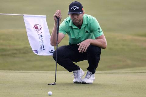 Sam Burns of Shreveport, La., lines up a putt at the 18th hole during the second round of the S ...