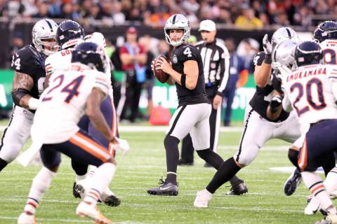 Oakland Raiders quarterback Derek Carr (4) drops back to pass during the first half of an NFL g ...