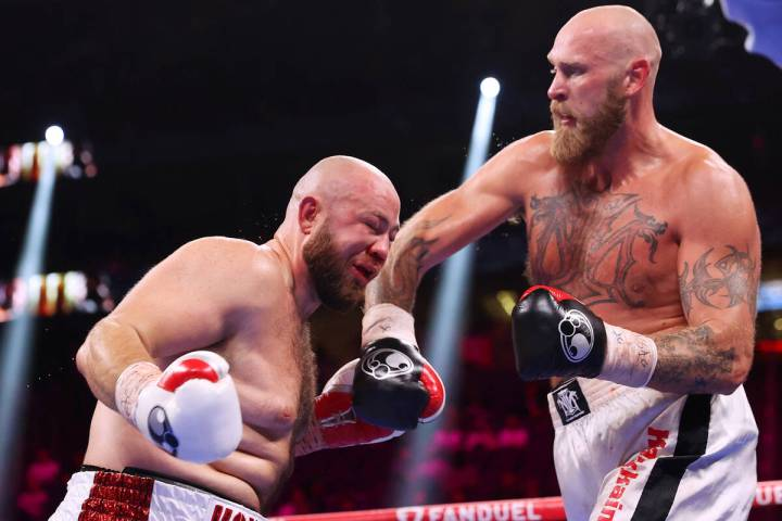 Robert Helenius, right, connects a punch against Adam Kownacki in the sixth round of a heavywei ...