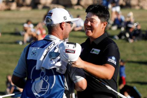 Sungjae Im, right, celebrates with his caddie after he won the final round of the Shriners Hosp ...