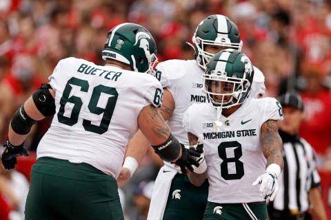 Michigan State wide receiver Jalen Nailor (8) is congratulated by Blake Bueter (69) after scori ...