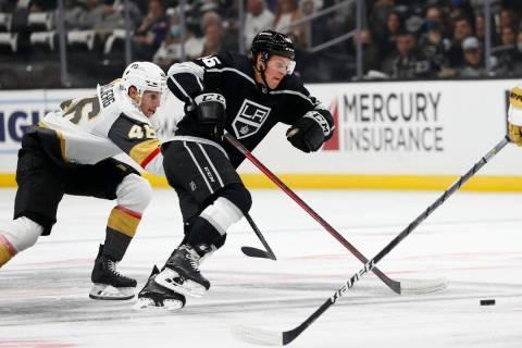 Vegas Golden Knights forward Jonas Rondbjerg, left, and Los Angeles Kings forward Blake Lizotte ...