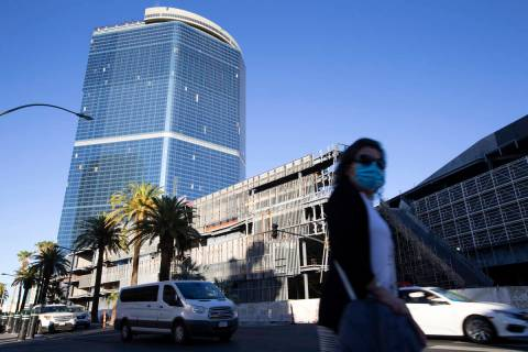 Pedestrians and traffic pass the unfinished former Fontainebleau building on Thursday, Oct. 14, ...