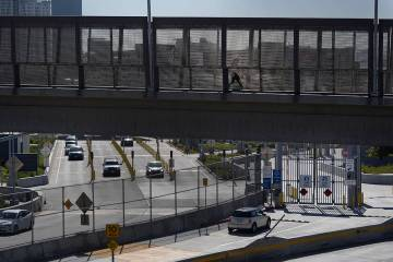 A few cars make their way north to cross into the United States from Tijuana, Mexico, Wednesday ...
