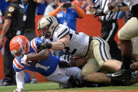 Florida wide receiver Jacob Copeland (1) scores a touchdown in front of Vanderbilt linebacker E ...