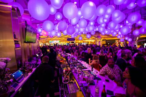People drink and mingle at Gatsby's cocktail lounge during the opening night of Resorts World L ...
