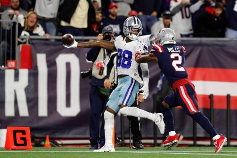Dallas Cowboys wide receiver CeeDee Lamb (88) stretches the ball over the goal line for the gam ...