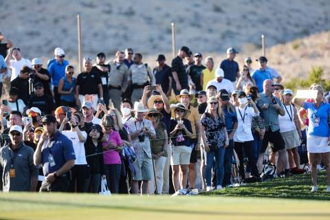 The crowds watch around the eighteenth hole CJ Cup golf tournament at the Summit Club in Las Ve ...