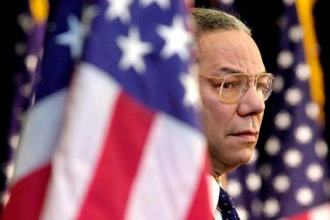FILE - In this Feb. 15, 2001 file photo, Secretary of State Colin Powell looks on as President ...