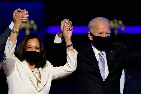Vice President Kamala Harris holds hands with President Joe Biden. (AP Photo/Andrew Harnik, File)