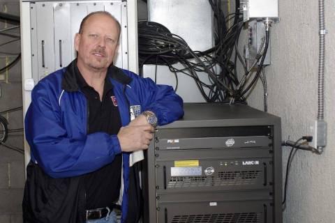Horace Langford Jr - KPVM Station owner Vern Van Winkle next to digital unit.