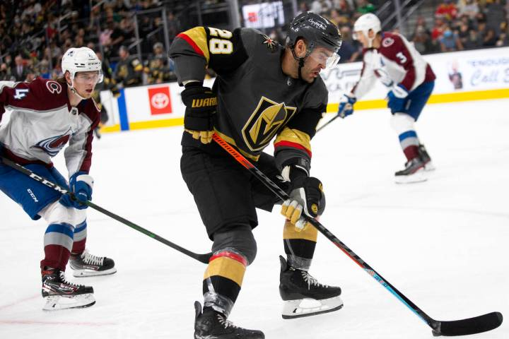 Golden Knights left wing William Carrier (28) gains control of the puck followed by Avalanche d ...