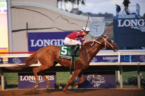 IMAGE DISTRIBUTED FOR LONGINES - Jockey Florent Geroux and Gun Runner cross the finish line to ...