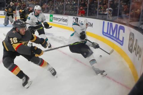 Vegas Golden Knights' Mattias Janmark (26) and San Jose Sharks' William Eklund (72) go after a ...