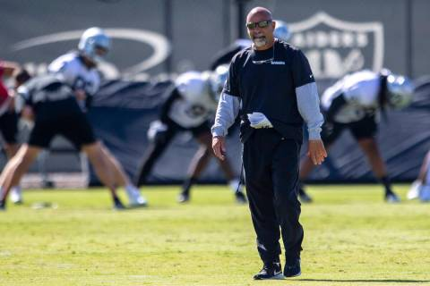 Raiders interim head coach Rich Bisaccia walks the field during a practice session at the Raide ...
