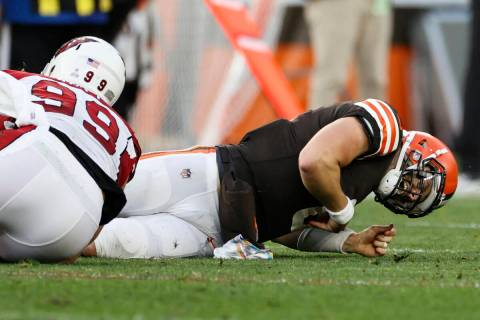 Cleveland Browns quarterback Baker Mayfield (6) gets injured on a hit by Arizona Cardinals defe ...