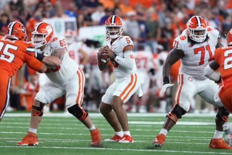 Clemson quarterback D.J. Uiagalelei (5) looks for a receiver during the fourth quarter of the t ...