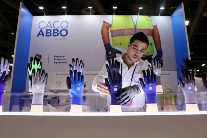 Isaac Joel Abbo of Caco America in Miami sets up his safety equipment products on the first day ...