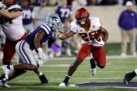 Iowa State running back Breece Hall (28) gets past Kansas State linebacker Wayne Jones (4) duri ...
