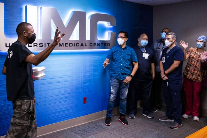The UMC Lions Burn Care Center team members greet a local chef and food truck owner Darrell Mar ...
