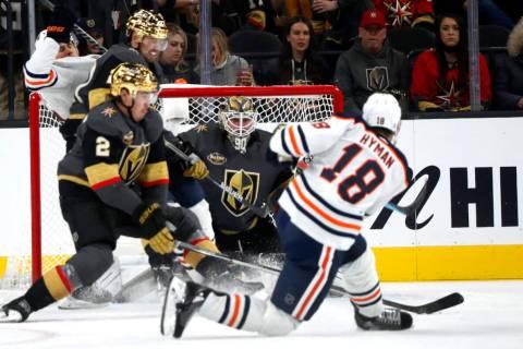 Edmonton Oilers left wing Zach Hyman (18) scores past Vegas Golden Knights goaltender Robin Leh ...