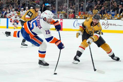 New York Islanders right wing Cal Clutterbuck (15) shoots in front of Vegas Golden Knights defe ...