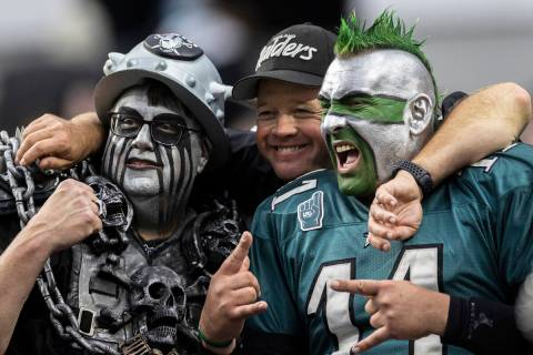 Philadelphia Eagles fans socialize with Raiders fans during an NFL football game on Sunday, Oct ...