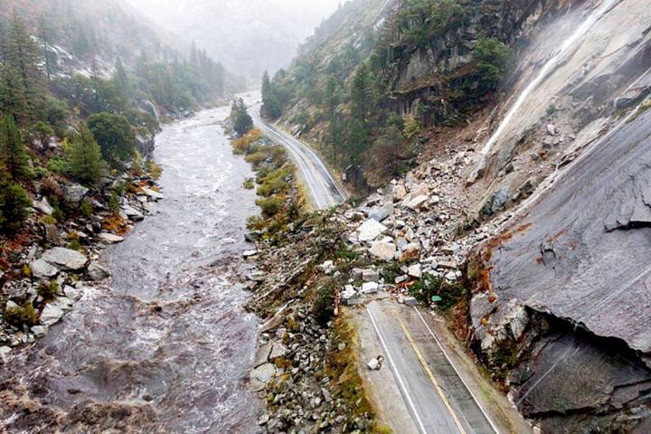 Rocks and vegetation cover Highway 70 following a landslide in the Dixie Fire zone on Sunday, O ...