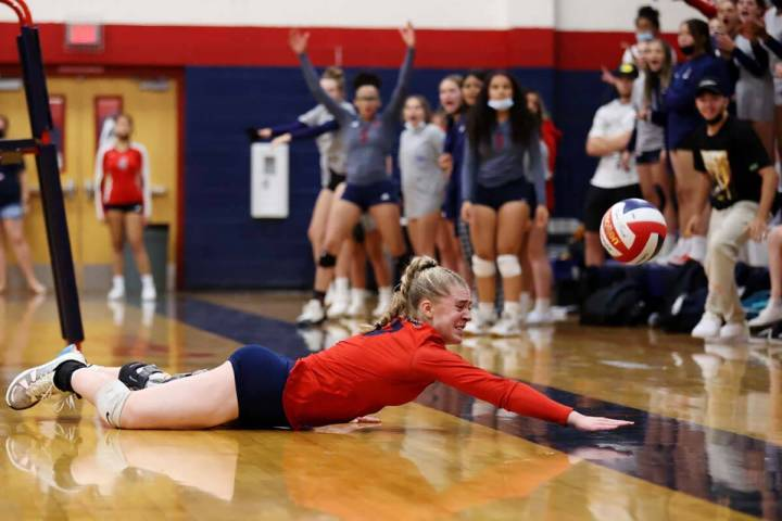 Coronado's Angelina Sayles (17) dives short to the ball for a Liberty point in a girls volleyba ...