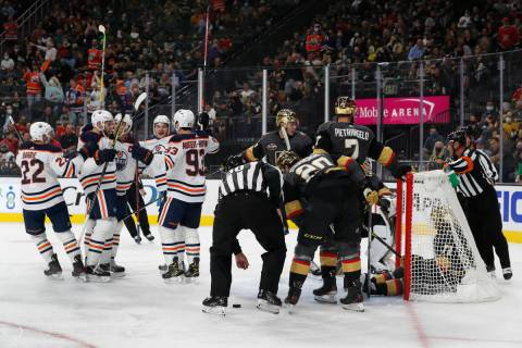 Edmonton Oilers celebrate a goal by left wing Zach Hyman (18) as Vegas Golden Knights center Wi ...